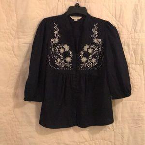 Dark NavyBlue/black tunic with cream accents.